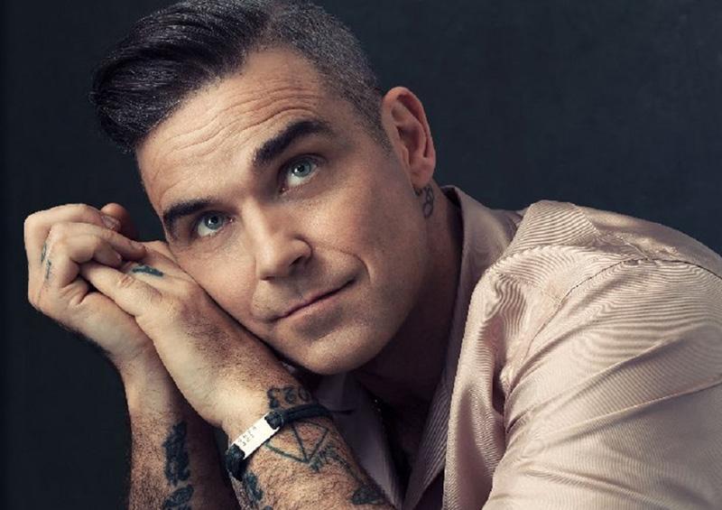 Robbie Williams se reunirá con Take That en concierto benéfico